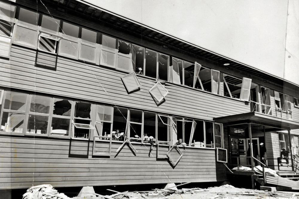Historical photo taken after the blast of some 5000 tons of TNT that rocked the U.S. Navy's Port Chicago on July 17, 1944, kiling 320 people. This is an Exterior view of barracks with sailors visible in windows.