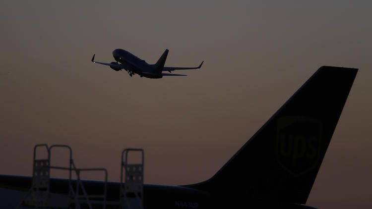 A plane takes off from John Wayne Airport.