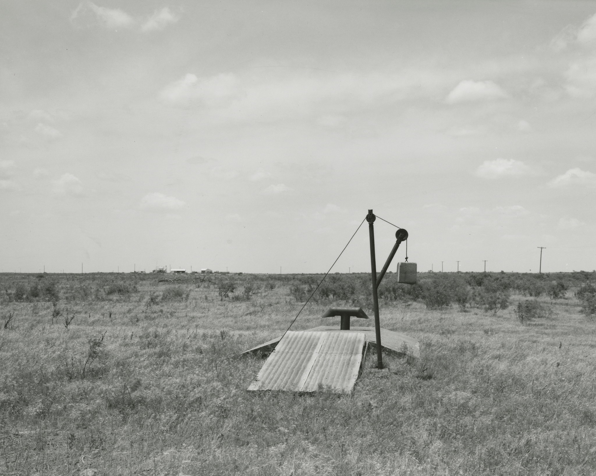 "Frank Gohlke, ""Storm cellar behind (vanished) foreman's house -- Ross Family ranch near Jolly, Texas,"" 1984."