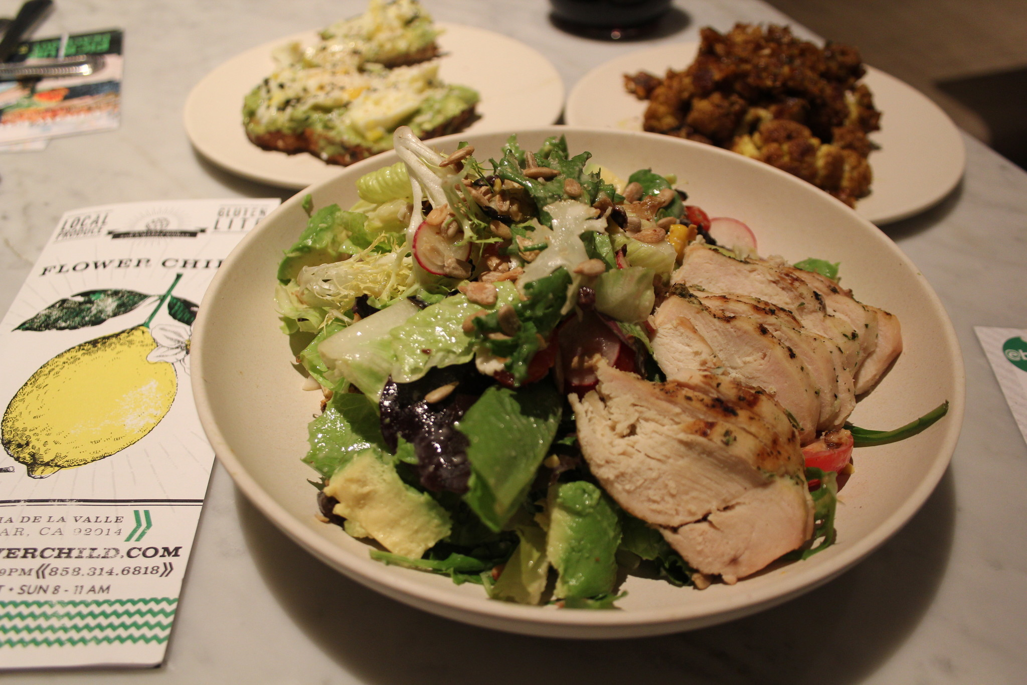 The menu includes mix-and-match veggie and grain dishes, salads, wraps and bowls. Many items are gluten-free or vegan.