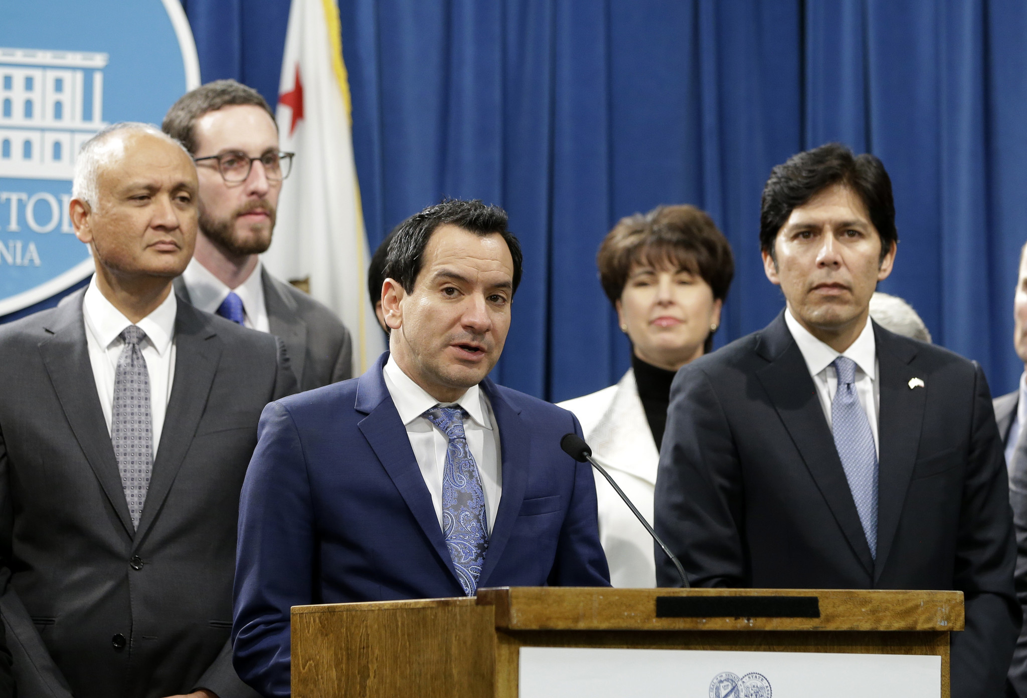 California Assembly Speaker Anthony Rendon, D-Paramount, third from left, flanked by Senate President Pro Tem Kevin de Len, D-Los Angeles, right, and other Democratic lawmakers, discusses a pair of proposed measures to protect immigrants, during a news conference in Sacramento.