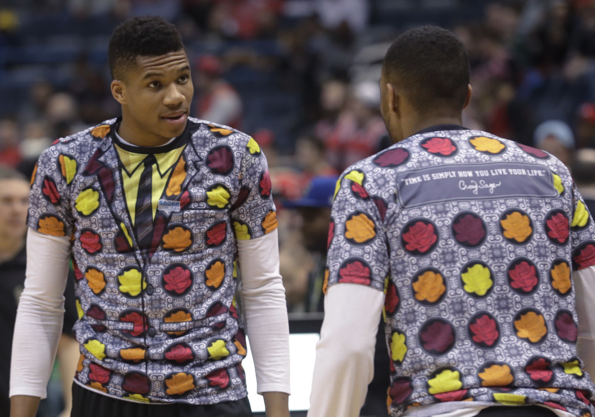 Milwaukee's Giannis Antetokounmpo, left, and Jabari Parker wear shirts to honor Craig Sager.