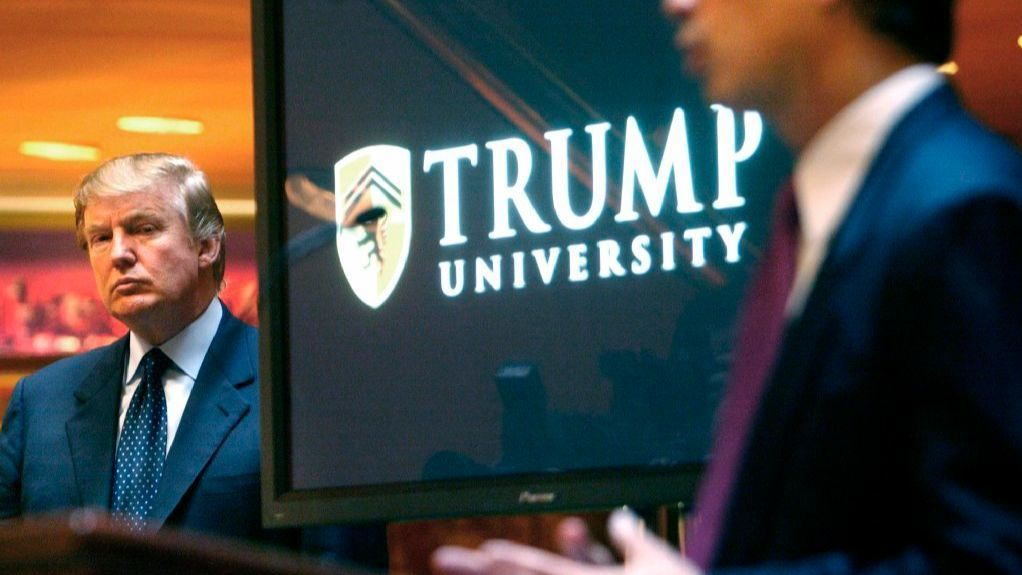 In this May 23, 2005 file photo, then real estate mogul and Reality TV star Donald Trump, left, listens as Michael Sexton introduces him at a news conference in New York where he announced the establishment of Trump University.
