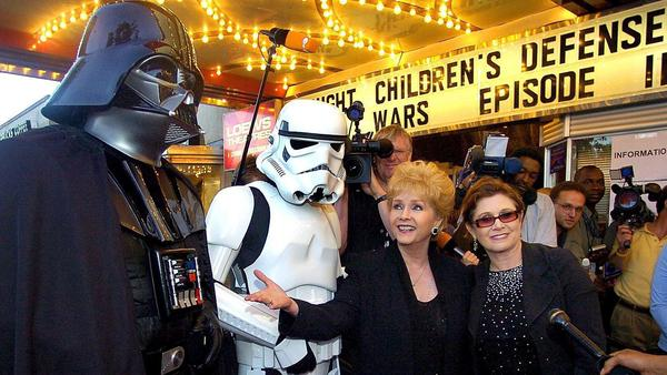 """Darth Vader, a stormtrooper, Debbie Reynolds and Carrie Fisher at the premiere of """"Star Wars Episode III: Revenge of the Sith"""" in Washington, DC. (Mark Theiler / European Pressphoto Agency)"""