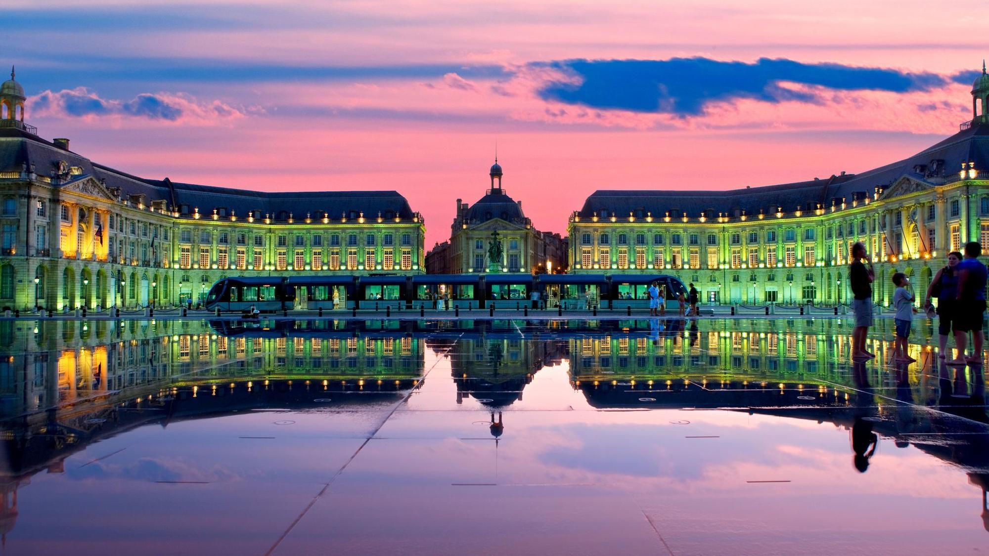 Ornamental water feature on  Place de la Bourse at dusk.