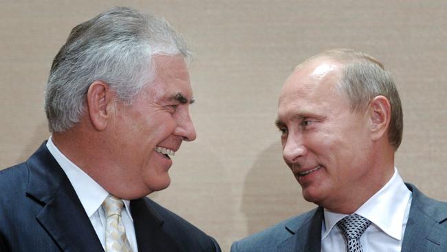 Russian Prime Minister Vladimir Putin, right, and then-Exxon Mobil Chief Executive Rex Tillerson meet in Sochi, Russia, on Aug. 30, 2011. (Alexei Druzhinin / Associated Press)