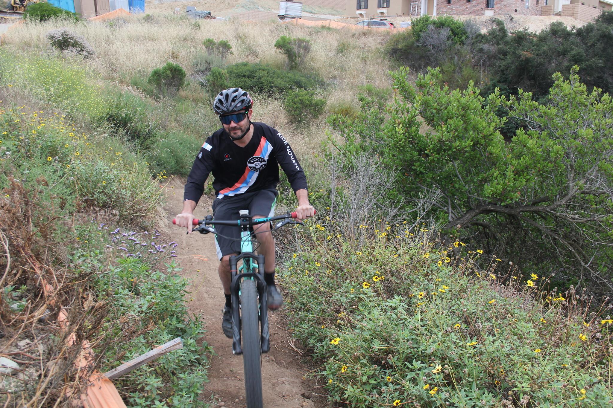 """A cyclist on the Del Mar Mesa """"Appendix"""" trail."""