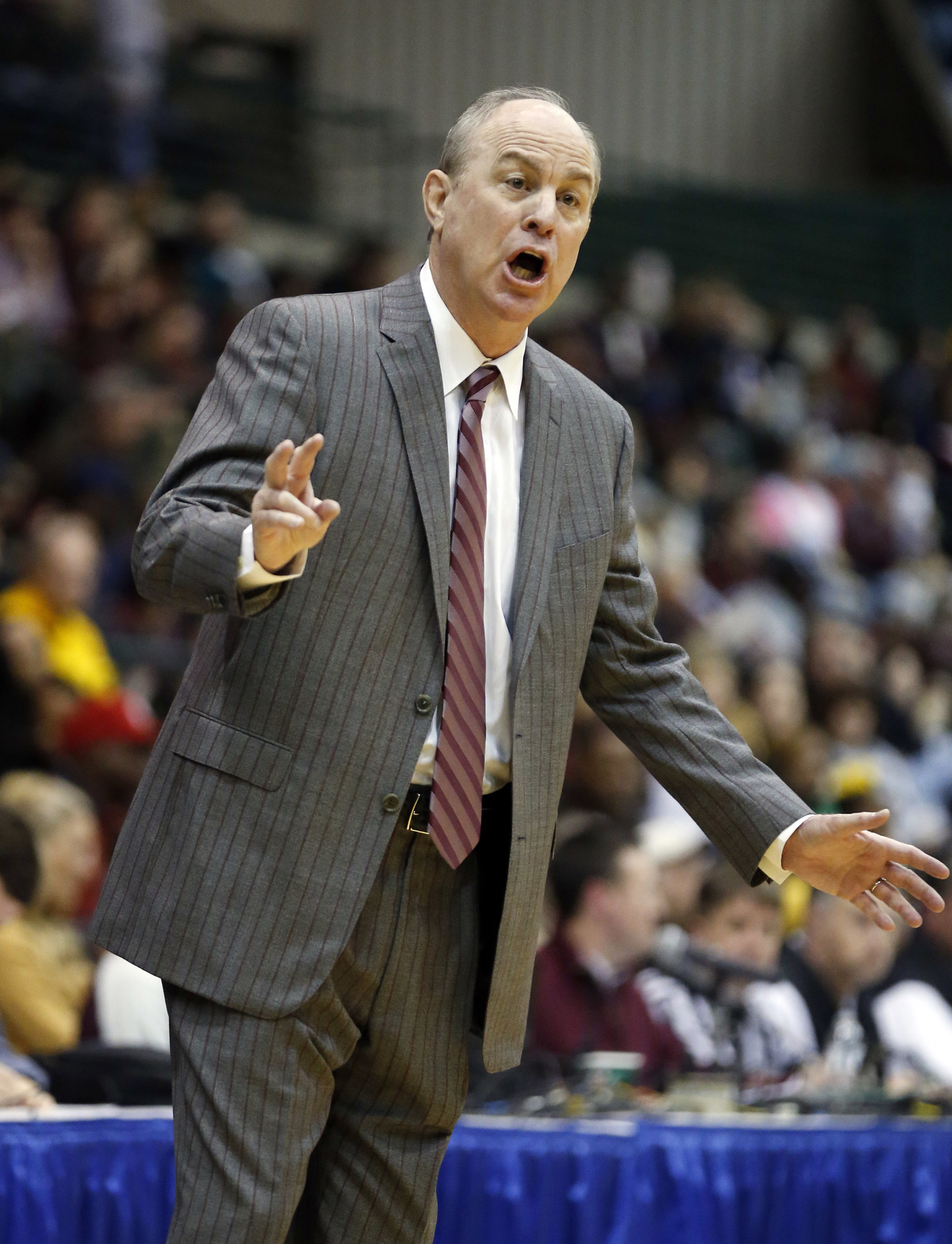 Mississippi State coach Ben Howland saves woman from ...