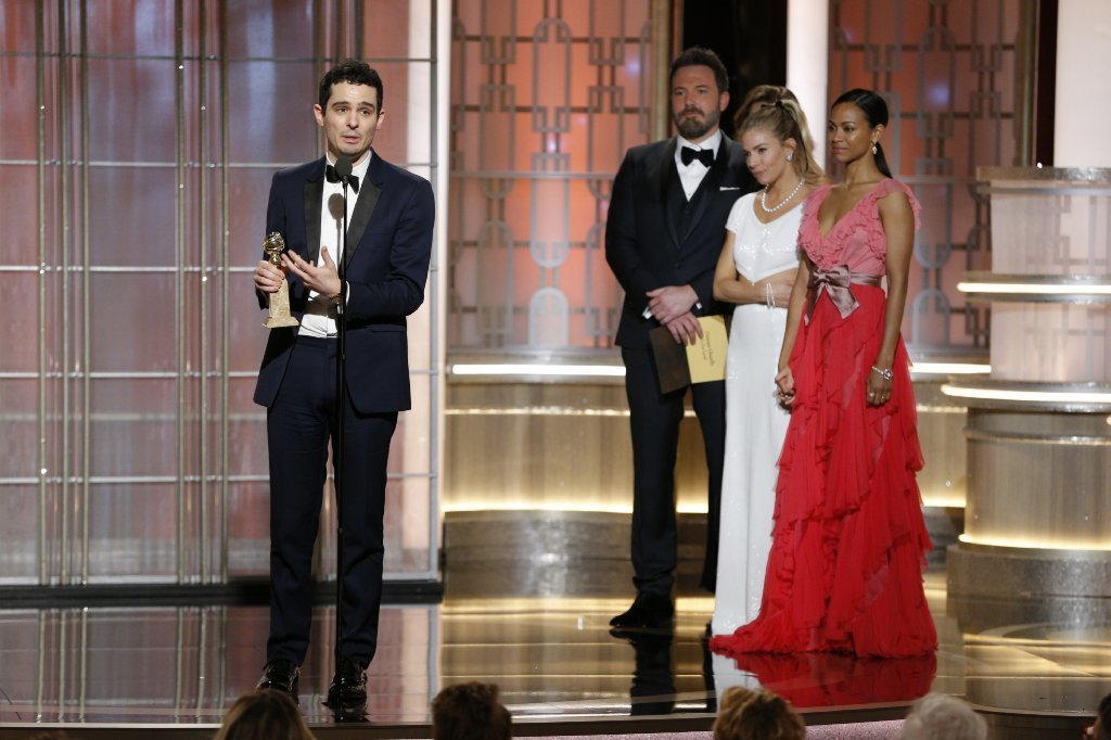 "Damien Chazelle accepts his director prize for ""La La Land"" at the 74th Golden Globe Awards at the Beverly Hilton Hotel. (Paul Drinkwater / NBC)"