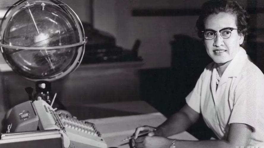 "Katherine Johnson sits at her desk with a globe known as a celestial training device. The lives of Johnson and other black female mathematicians and engineers are featured in the film ""Hidden Figures."""