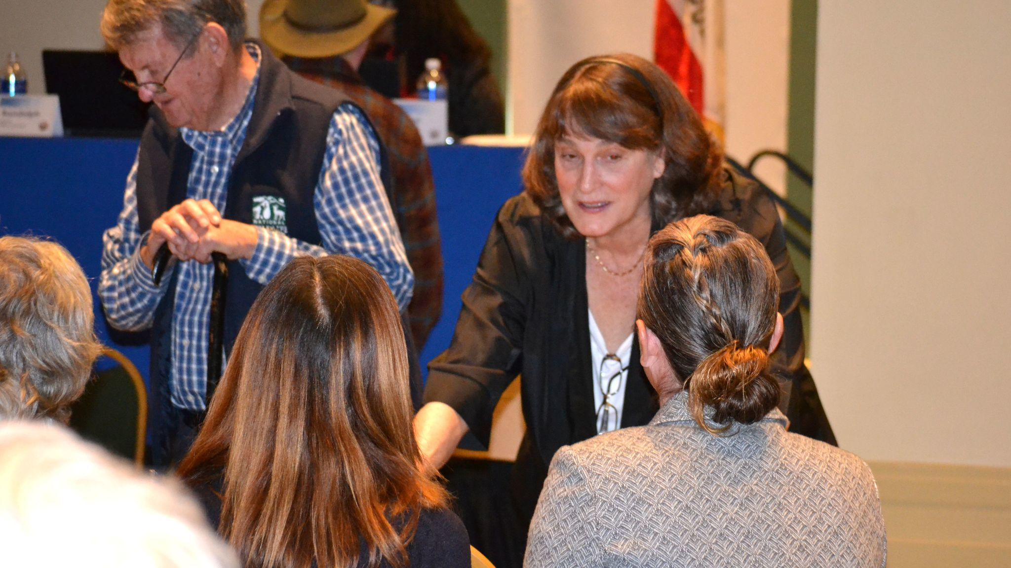 Diane Conklin, spokesperson for the Mussey Grade Road Alliance, talks with attendees during a break at the public participation hearing.