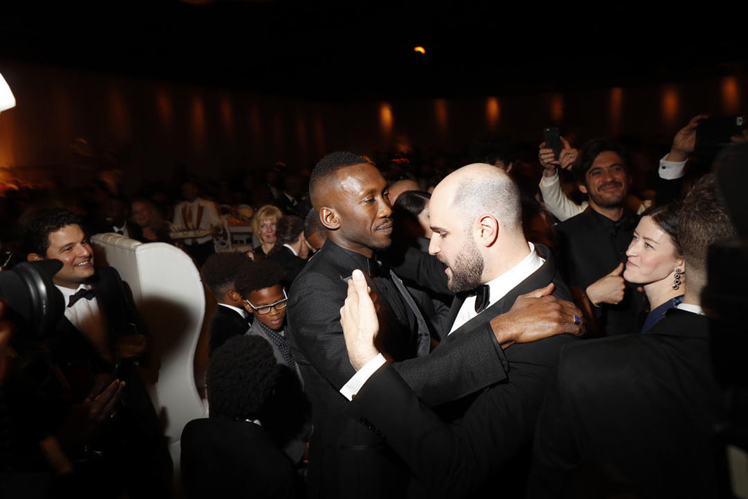 """Moonlight"" actor Mahershala Ali and ""La La Land"" producer Jordan Horowitz embrace after the Oscars."