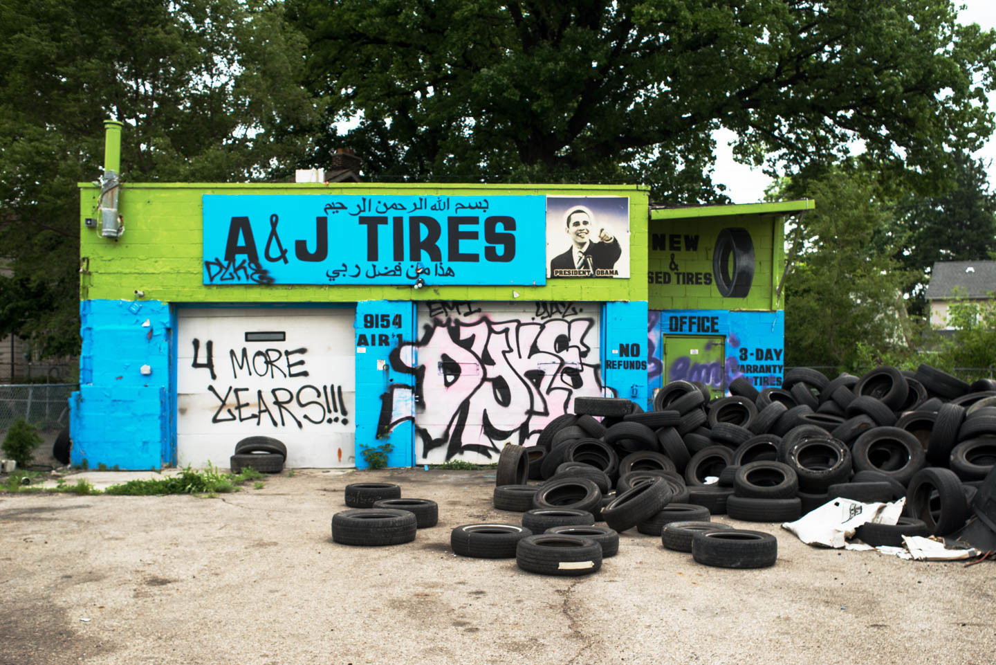 A. and J. Tires, 9154 Livernois Ave., Detroit, 2014 (above) and 2015 (right)