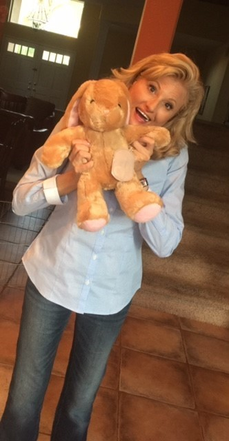 Dawnette Meredith with her stuffed rabbit with ostomy bag that inspired Awesome Ollie.