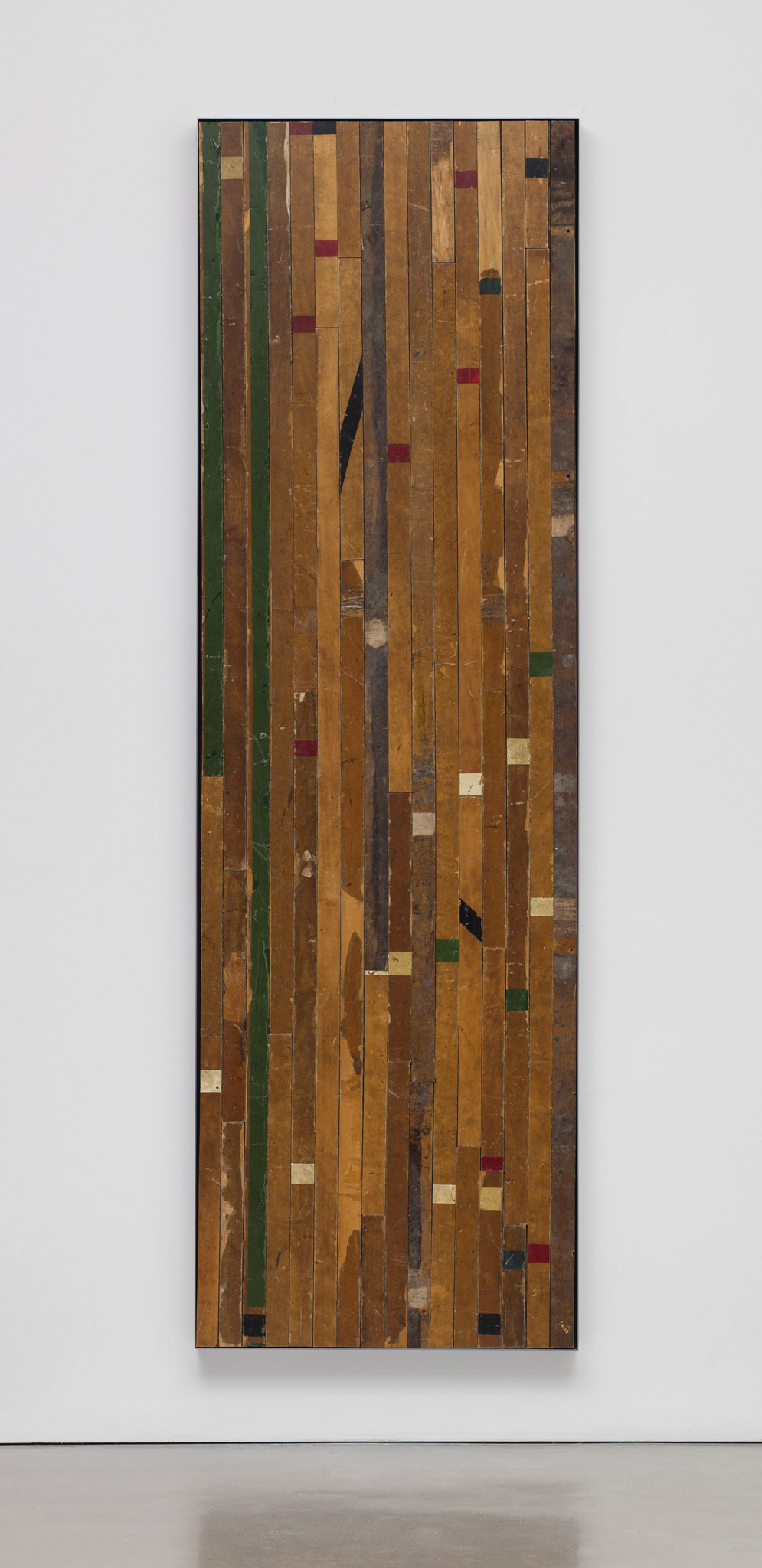 """Theaster Gates' """"Ground rules. Green scrimmage 2,"""" 2015, wooden flooring, framed dimensions 120 1/4 inches by 37 3/8 inches by 2 7/8 inches."""