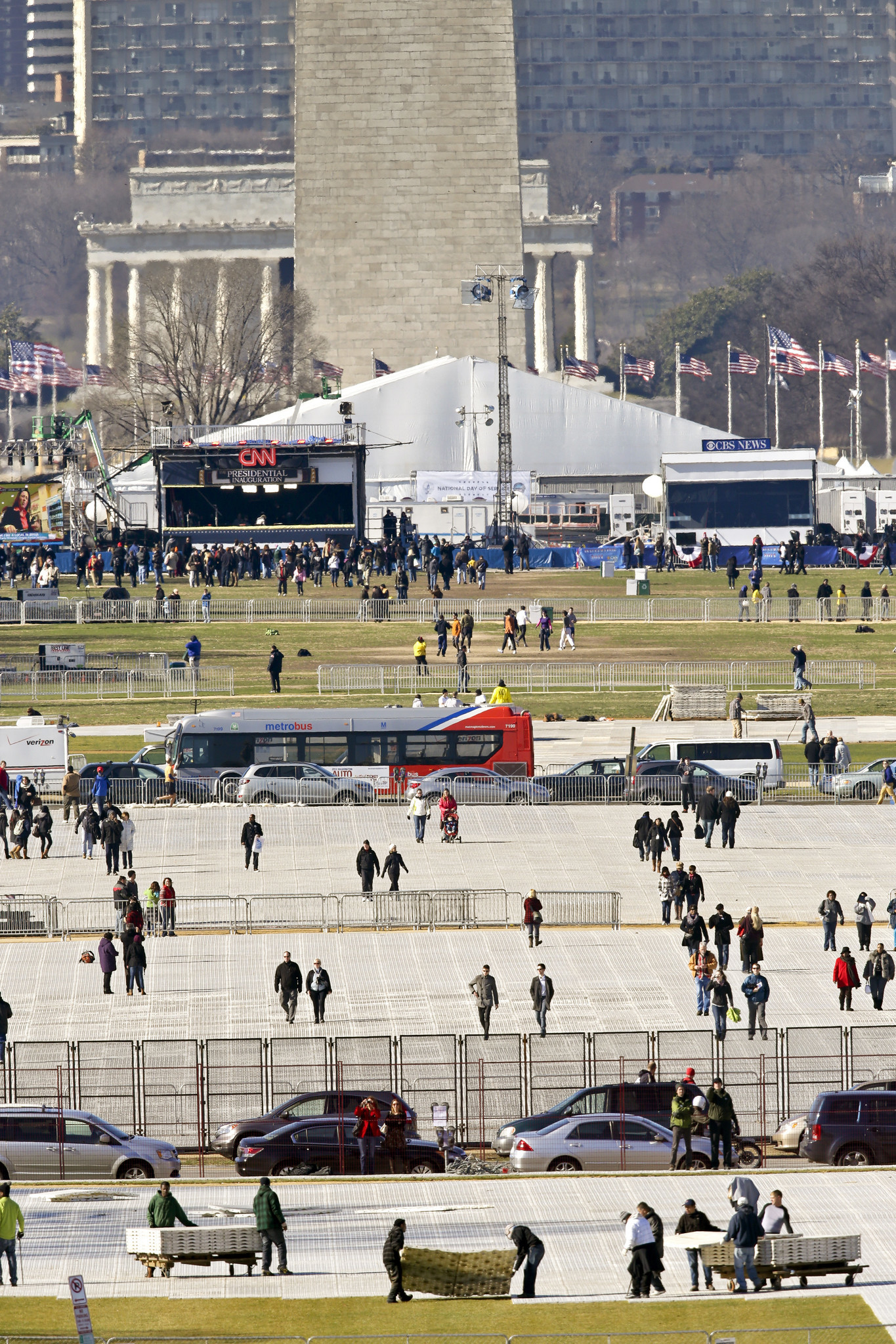 Crews lay down mats to protect the lawn on the National Mall before President Obama's second inauguration in 2013.