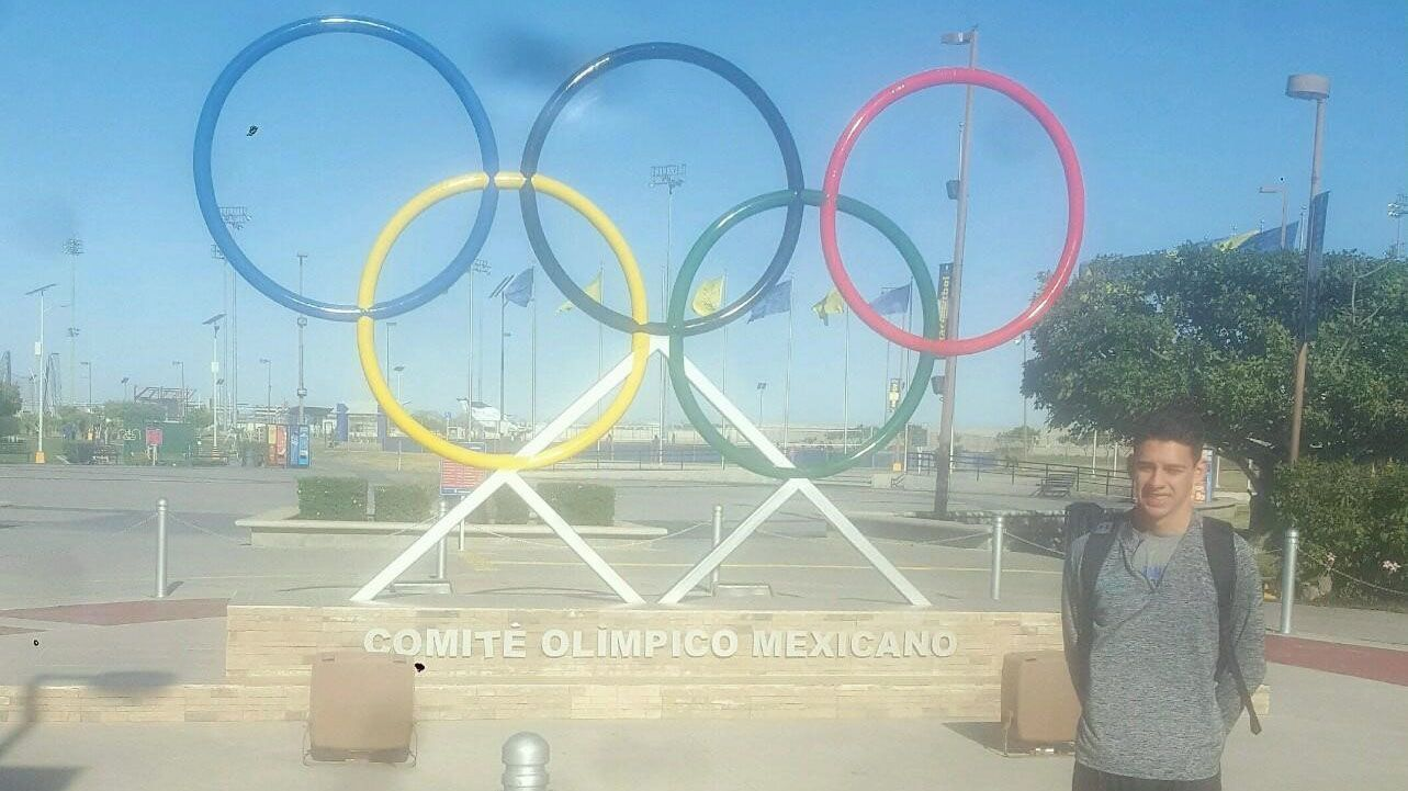 Armando Abarca, who plays with the Mexican national volleyball team, stands in front of the Comite Olimpico Mexicano in Tijuana.