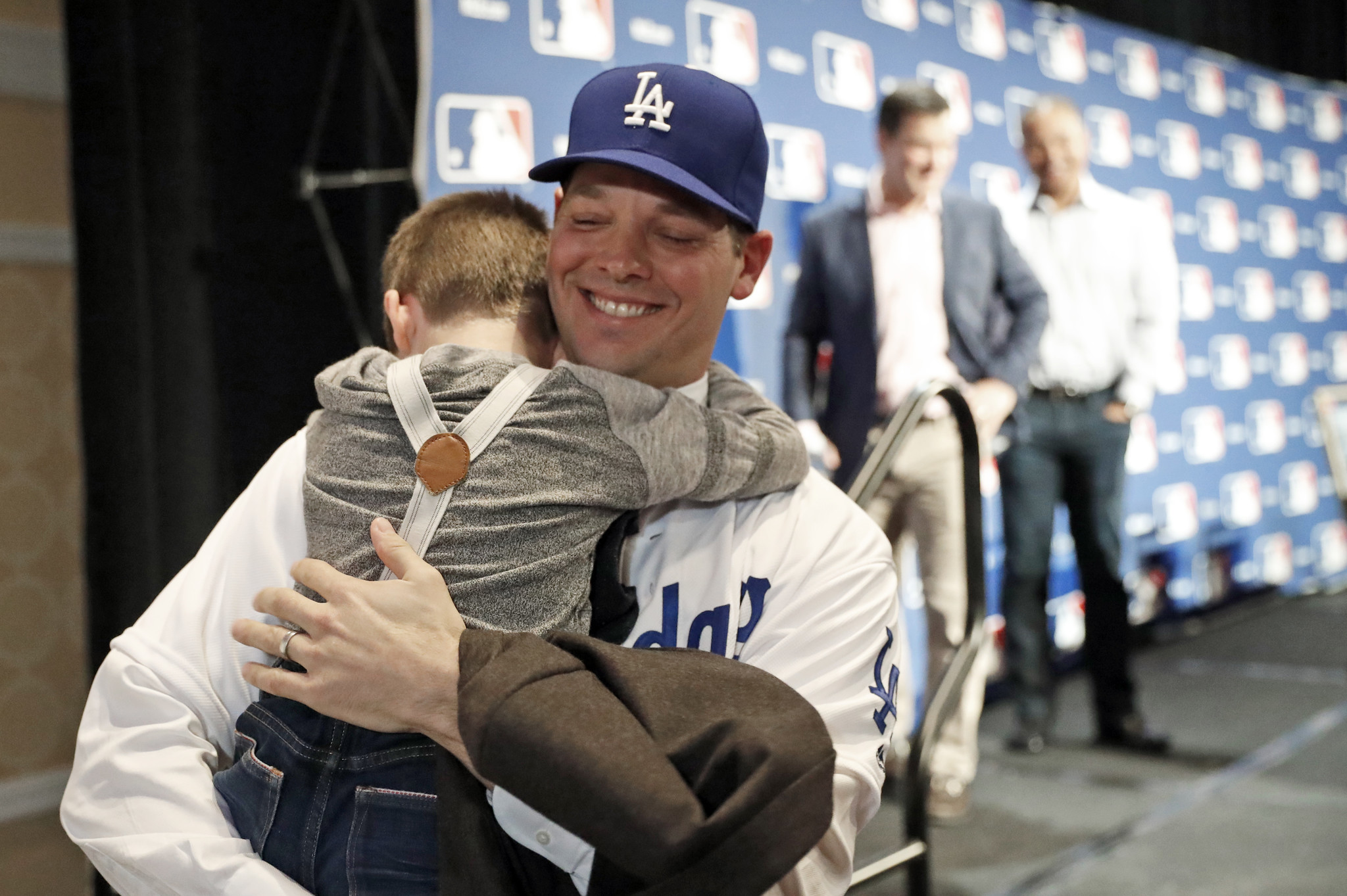Rich Hill hugs his son Brice, 5, after the pitcher's new three-year deal with the Dodgers was announced at Major League Baseball's winter meetings on Dec. 5.