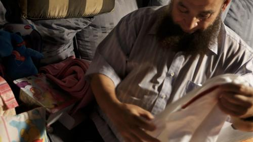 Mohamed Bzeek spends long days and sleepless nights caring for the bedridden child.