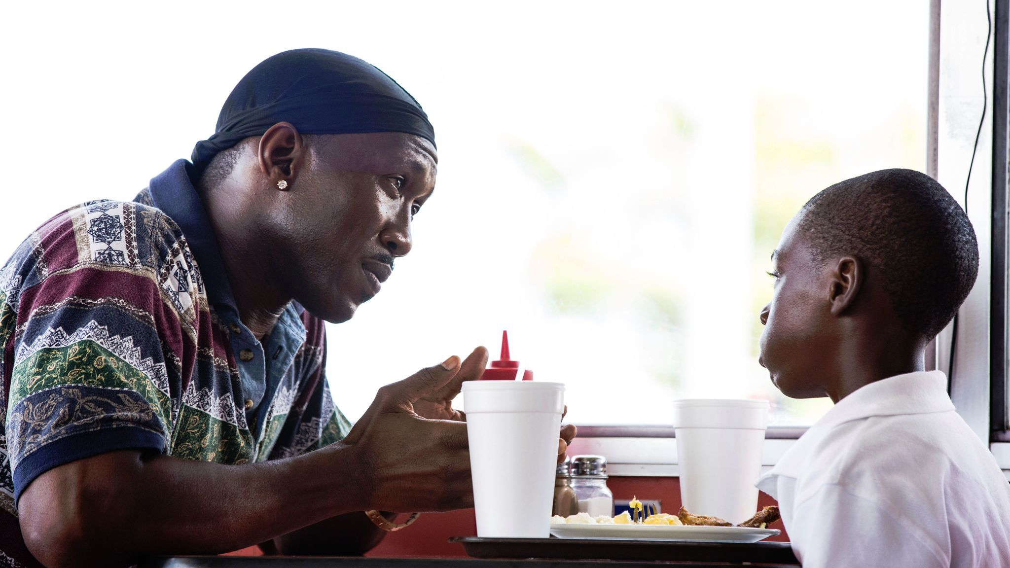 Mahershala Ali, left, and Alex Hibbert in a scene from
