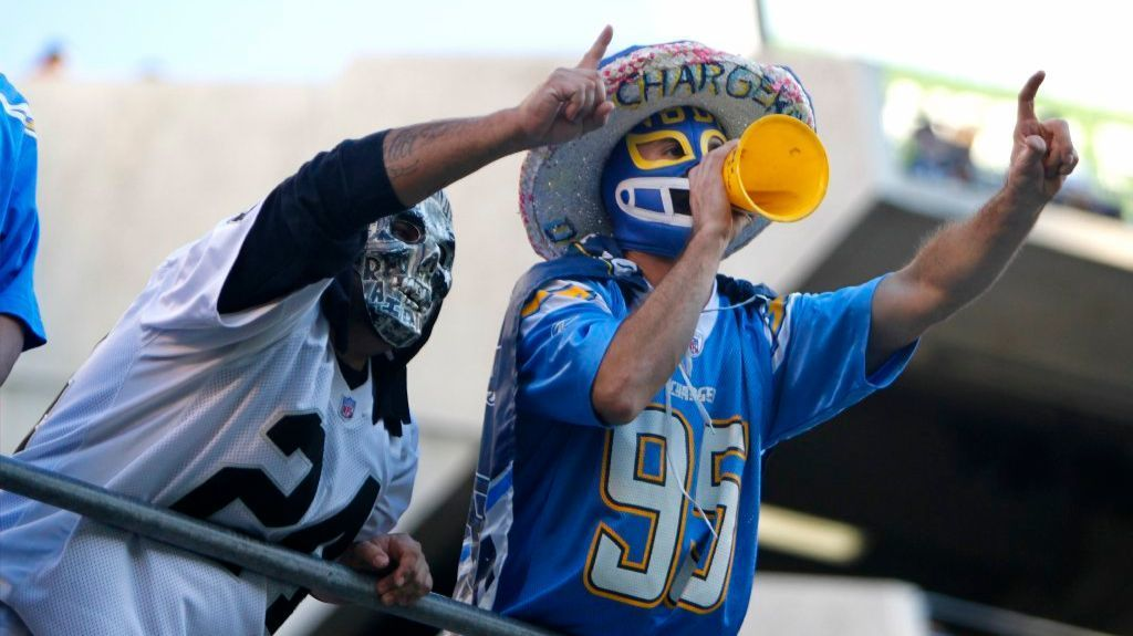 San Diego Chargers and Oakland Raiders fans cheer during a game at Qualcomm Stadium on Dec. 18, 2016.