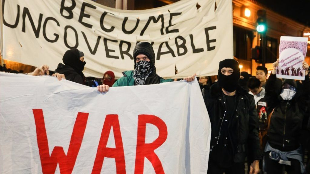 People protesting controversial Breitbart writer Milo Yiannopoulos take to the streets on February 1, 2017 in Berkeley, California.