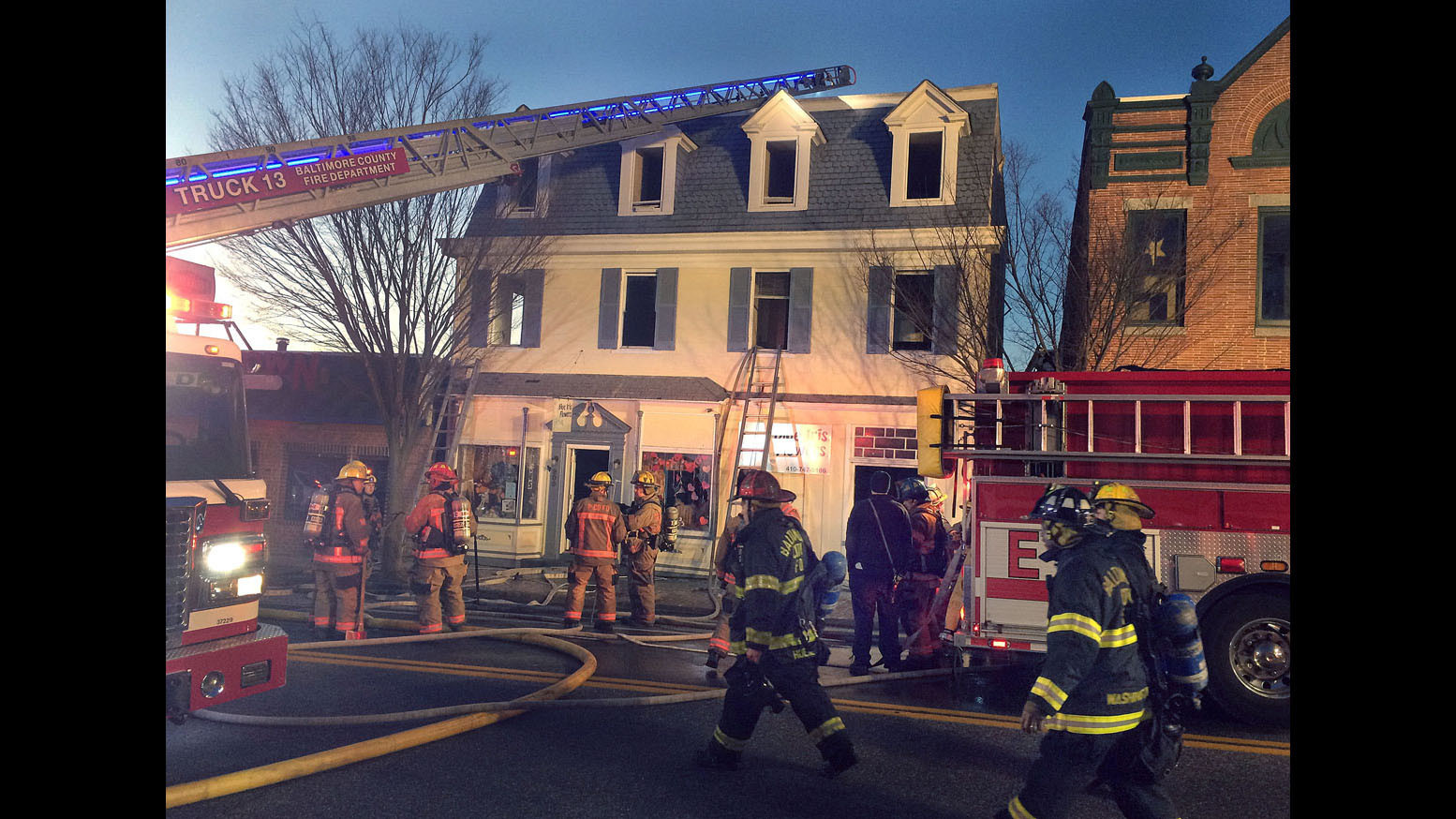 two alarm fire burns blue iris flowers century old building in