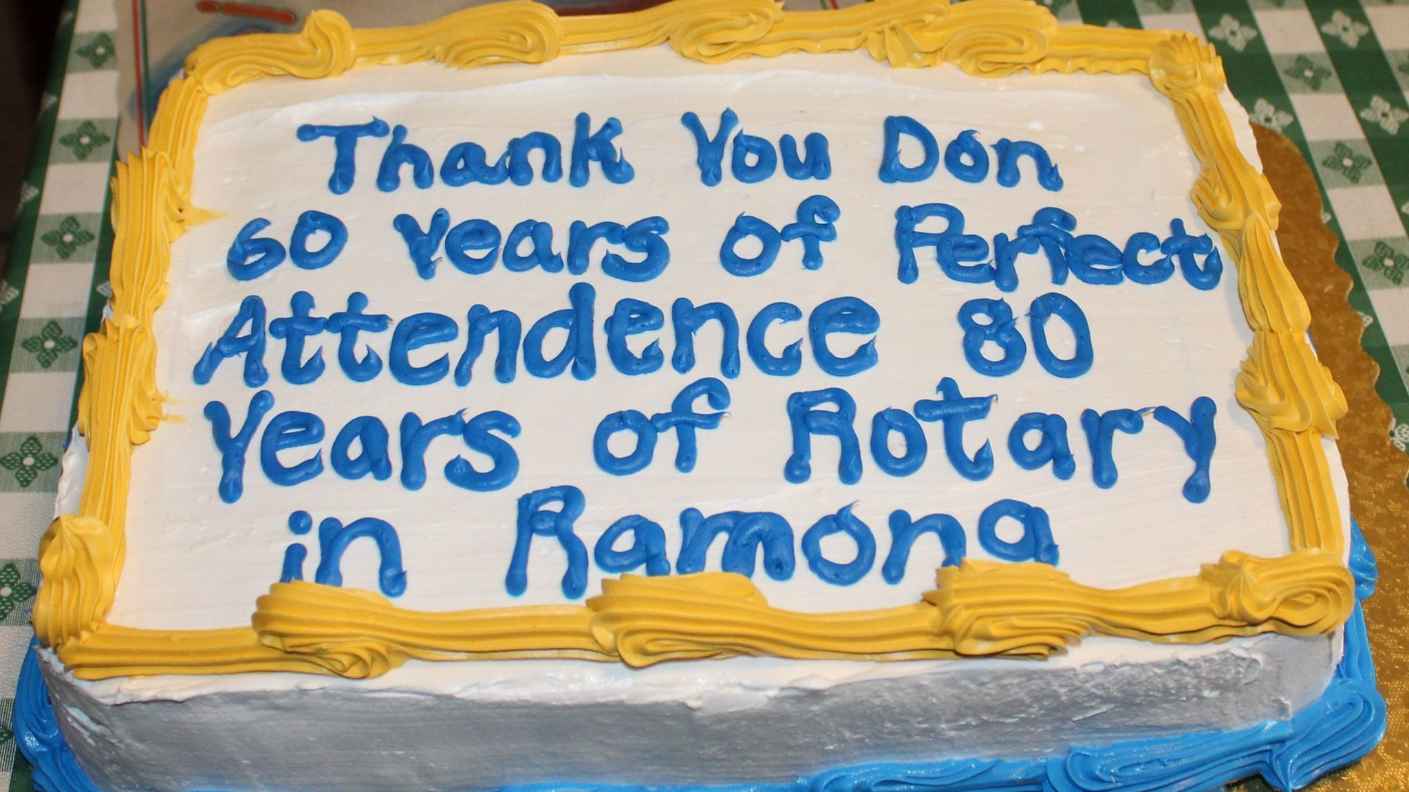 Cake celebrates two anniversaries: Ramona Rotary Club's 80th year and Rotarian Don Owen's 60 years of perfect attendance.