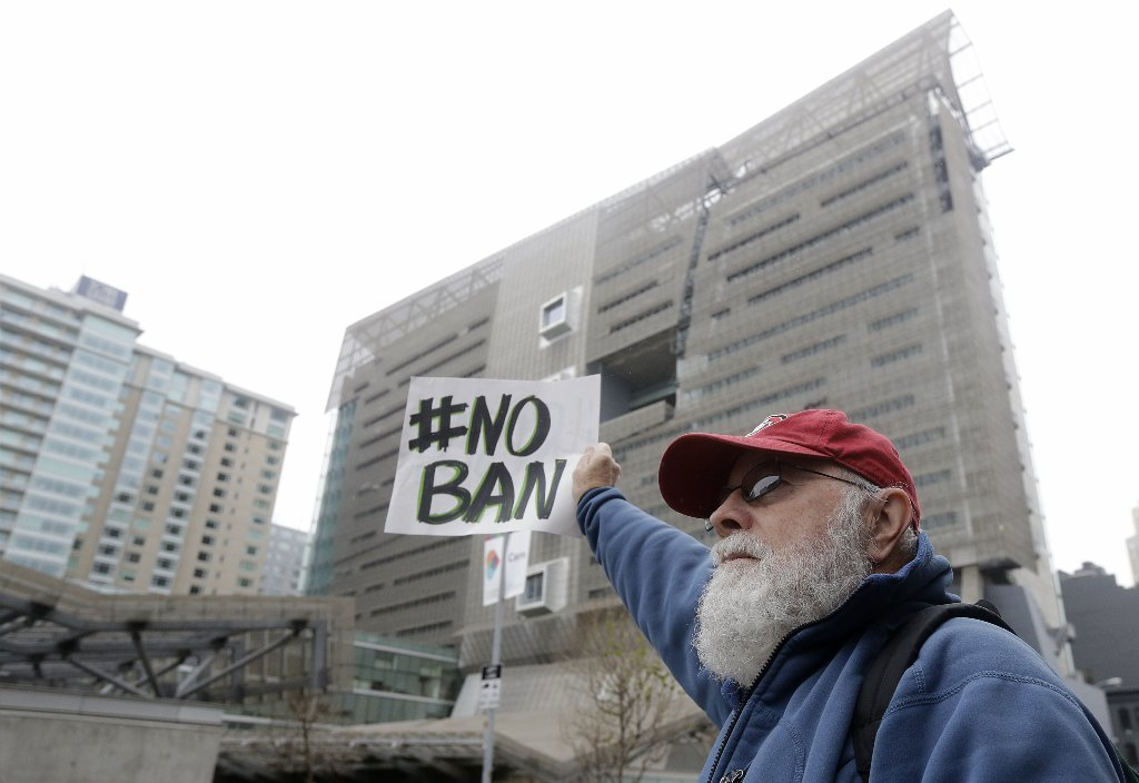 David Pearce holds a sign outside of the 9th U.S. Circuit Court of Appeals in San Francisco, Tuesday, Feb. 7, 2017.