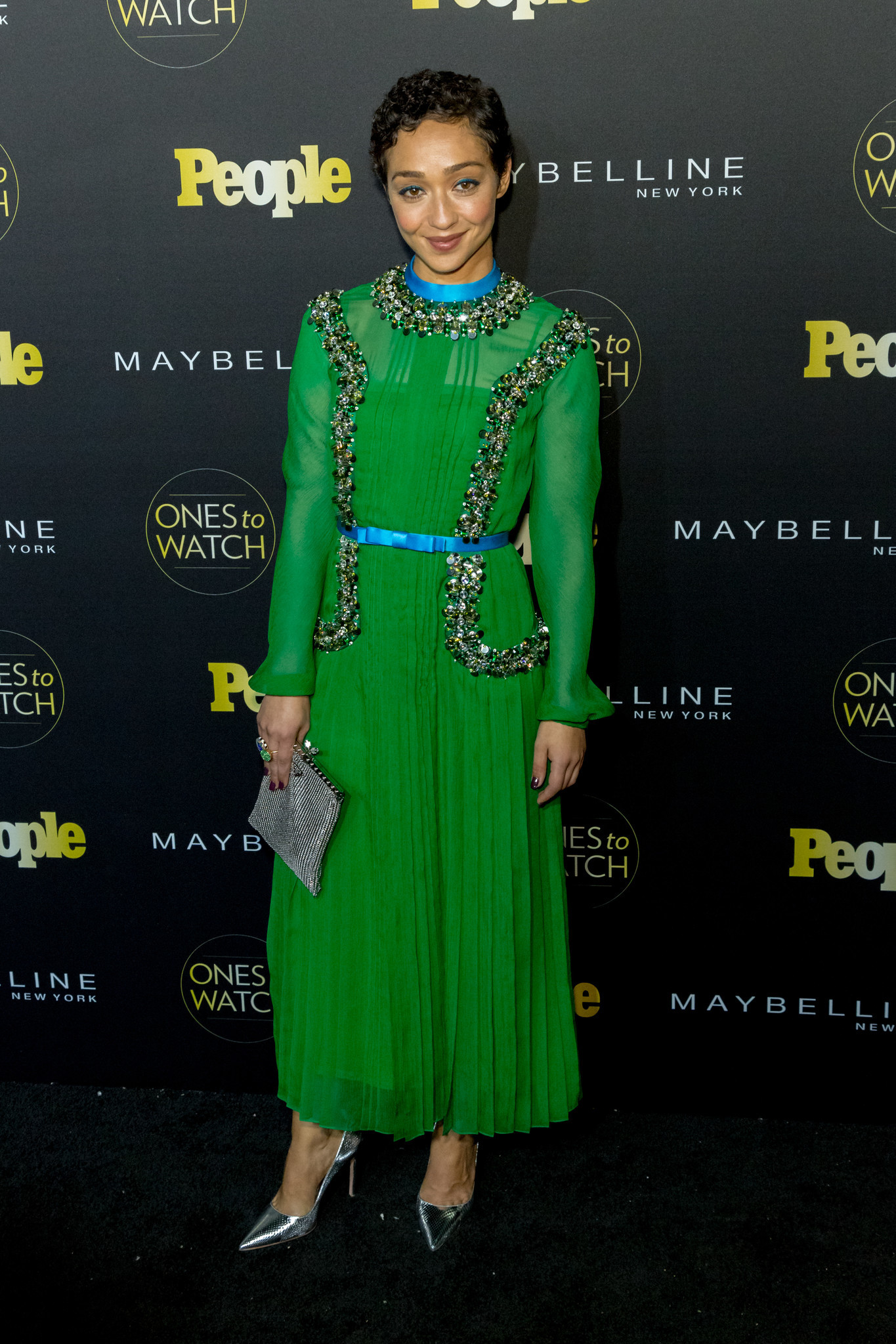 An emerald Prada gown's unusual trimming highlights Negga's blend of strength and delicacy.