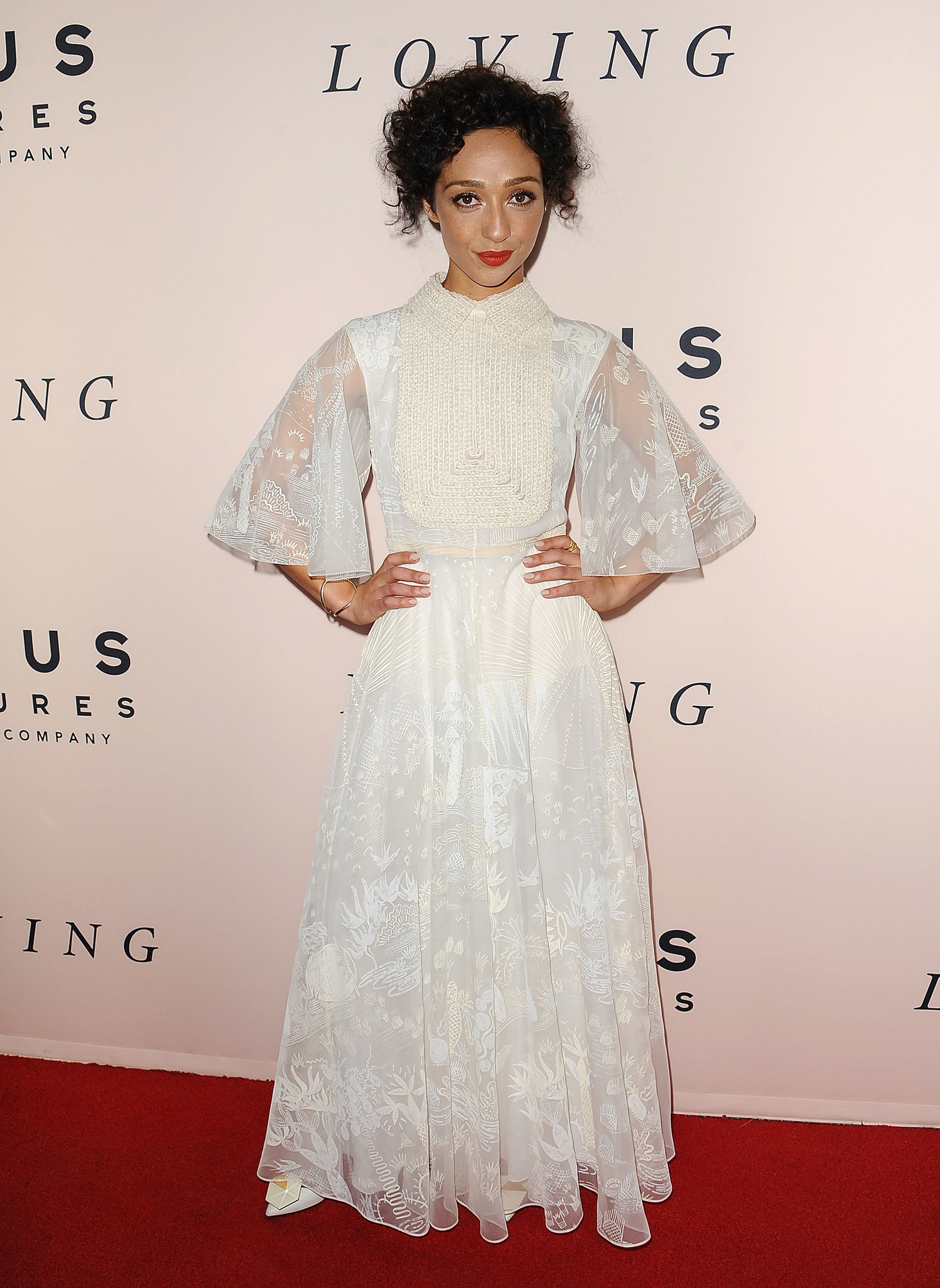 """Negga personified retro romance at the Los Angeles """"Loving"""" premiere, wearing a flowing white Valentino with cape sleeves, bib-front and all-over embellishment."""