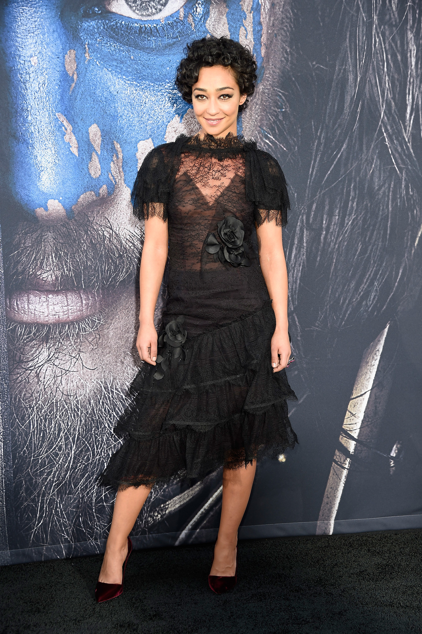 """She's sweet and slightly sinister in a sheer, black lace tiered-dress by Rodarte at the L.A. premiere of """"Warcraft"""" last year."""