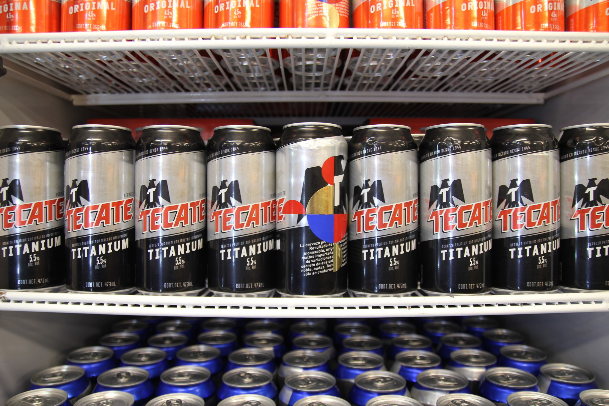 A can of Tecate bears an Orozco tag in the refrigerator.