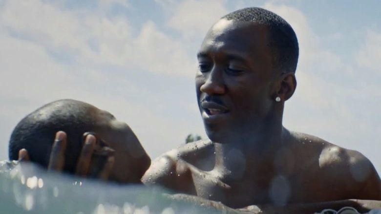 "Mahershala Ali with Alex R. Hibbert in ""Moonlight."""
