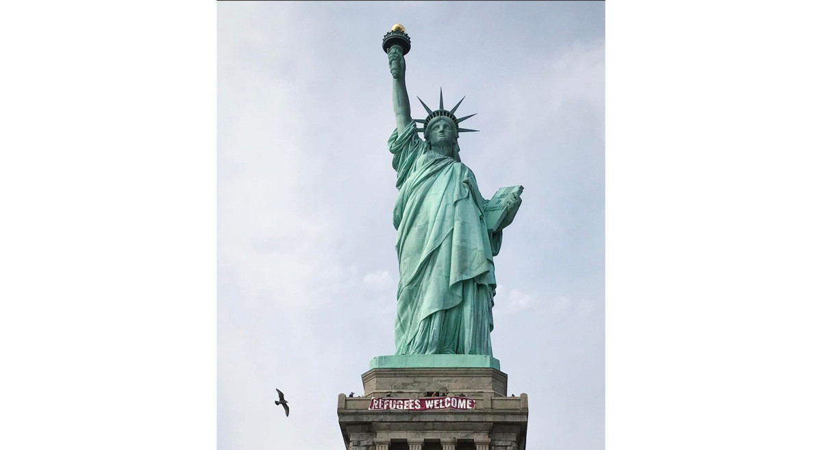 'Refugees Welcome' banner unfurled at Statue of Liberty ...