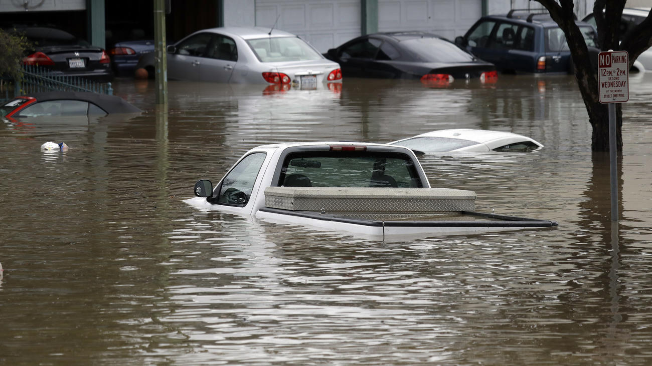 Floodwaters submerge cars in a San Jose neighborhood in February.