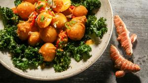 Turmeric-braised baby potatoes with coconut kale