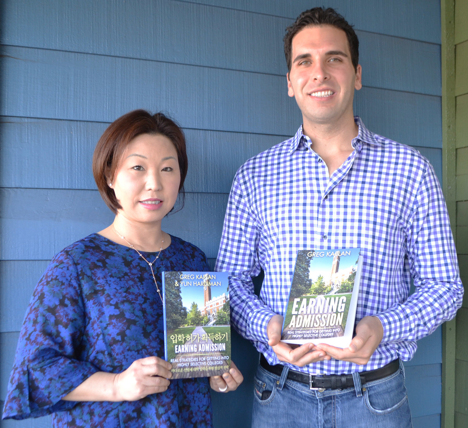 """Earning Admission"" authors Yun Hardiman and Greg Kaplan holding their Korean and English versions of their book, respectively."