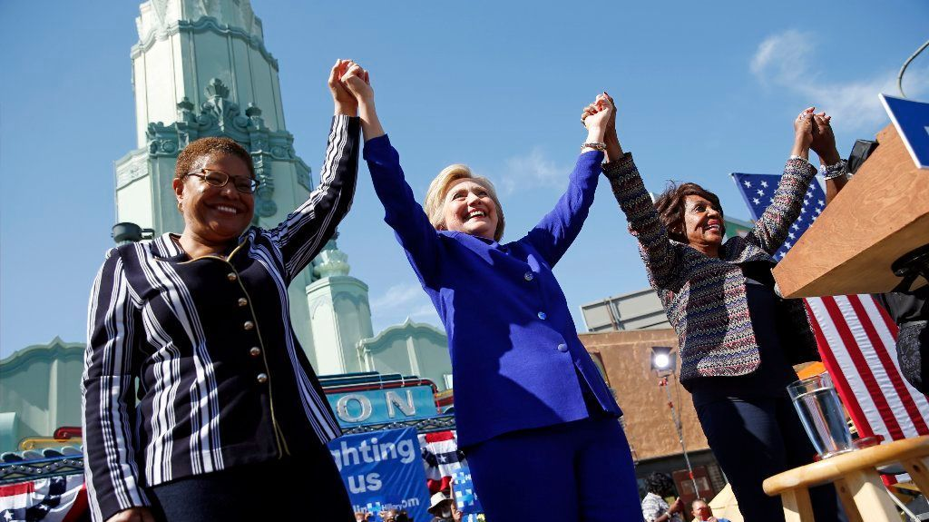 Democratic presidential candidate Hillary Clinton, center, celebrates at a rally with Rep. Karen Bass, D-Calif., left, and Rep. Maxine Waters, D-Calif., Monday, June 6, 2016, in Los Angeles