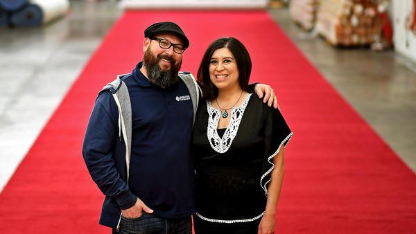Moises Arteaga and Lynn Nichols of Signature Systems Group at the company's Santa Fe Springs warehouse.