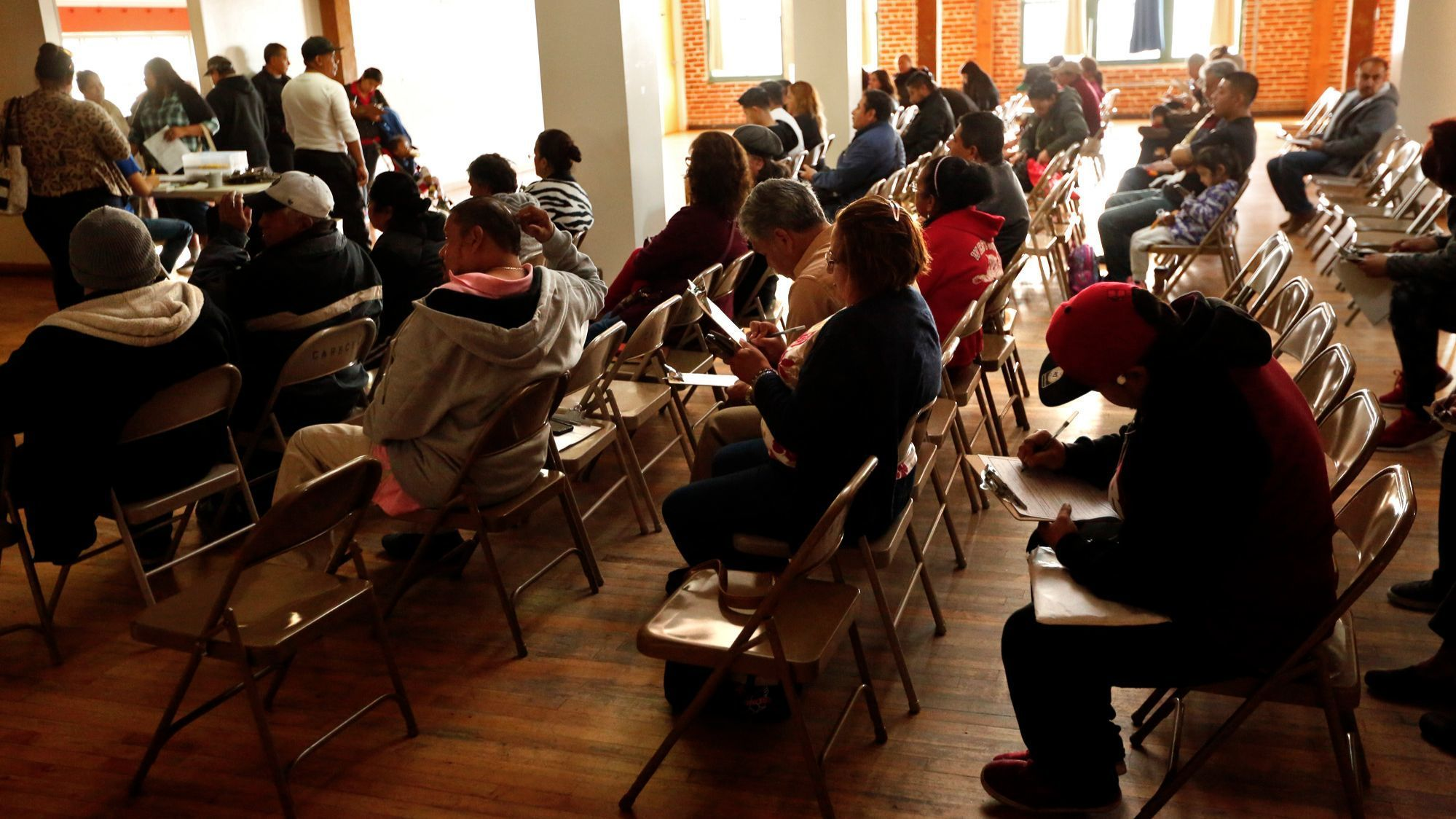 Immigrants, some in the country illegaly, fill out intake forms before receiving legal help and direction with their immigration cases on consultation day at the Central American Resource Center.