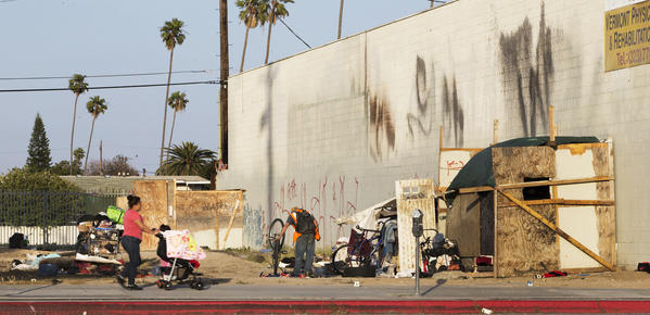 A homeless encampment on a South Los Angeles vacant lot that was supposed to be developed into an entertainment district, on May 27, 2016. (Los Angeles Times)