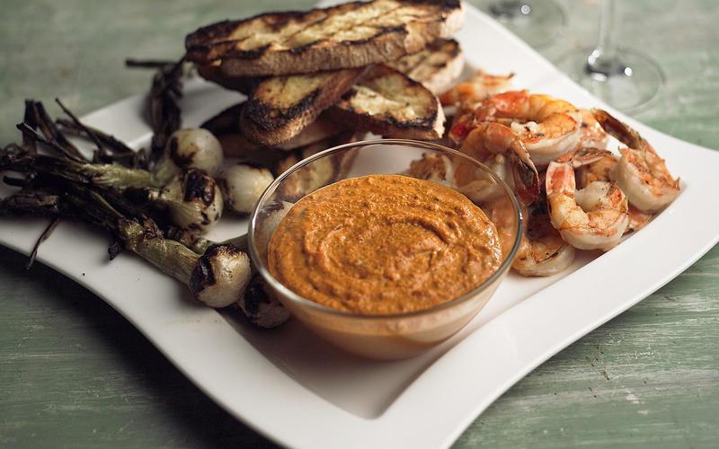 Romesco with grilled bread, spring onions and shrimp