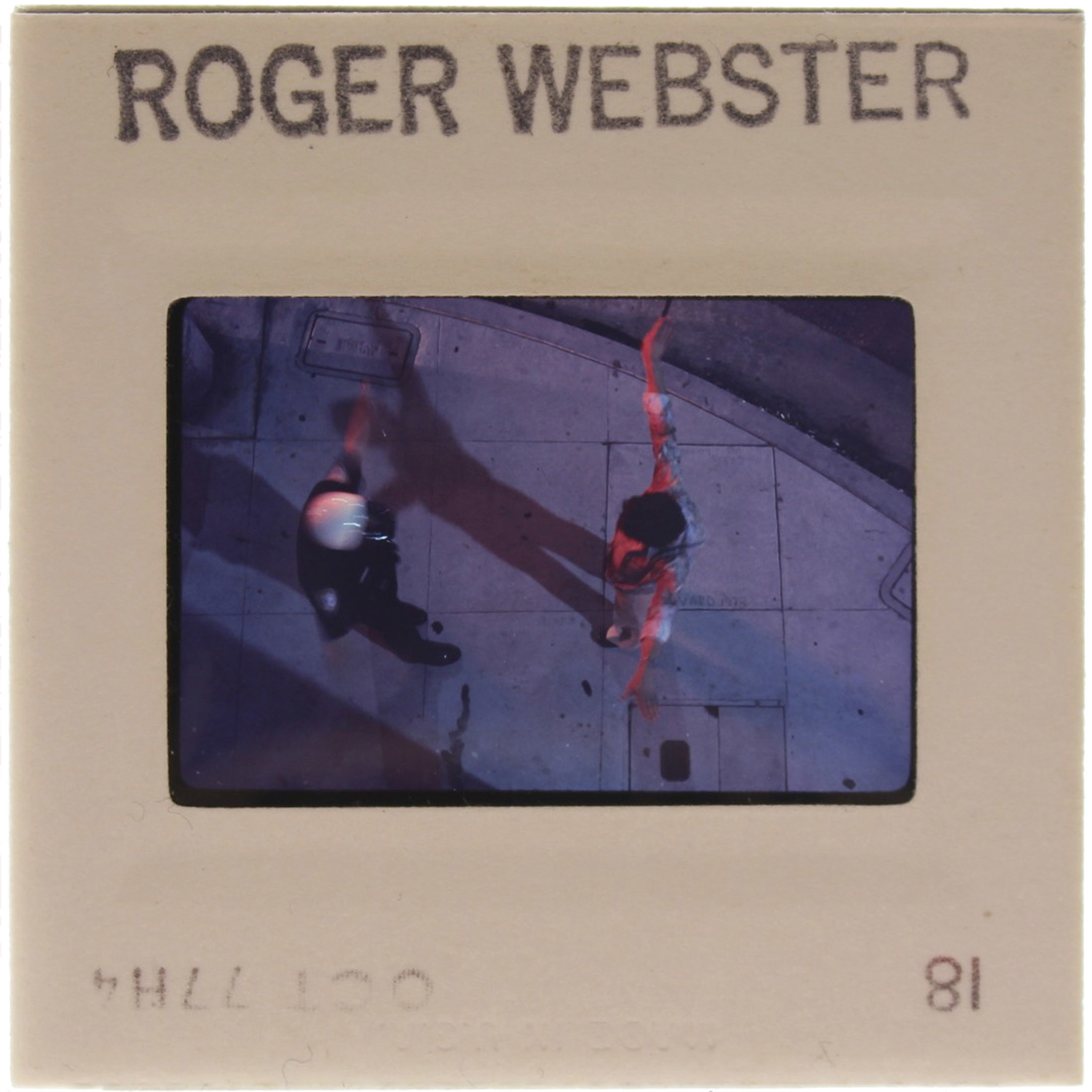 A photograph by Roger Webster of a sidewalk encounter with the Los Angeles police.
