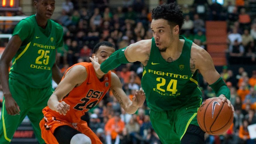 Oregon's Dillon Brooks gets past Oregon State's Kendal Manuel during a game on March 4.