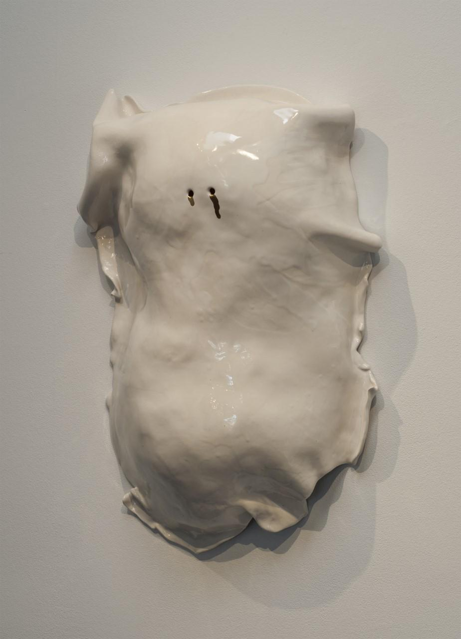 """Sharon Engelstein's """"Blind Mask,"""" 2016, glazed ceramic, 22 inches by 14 inches by 4 inches."""