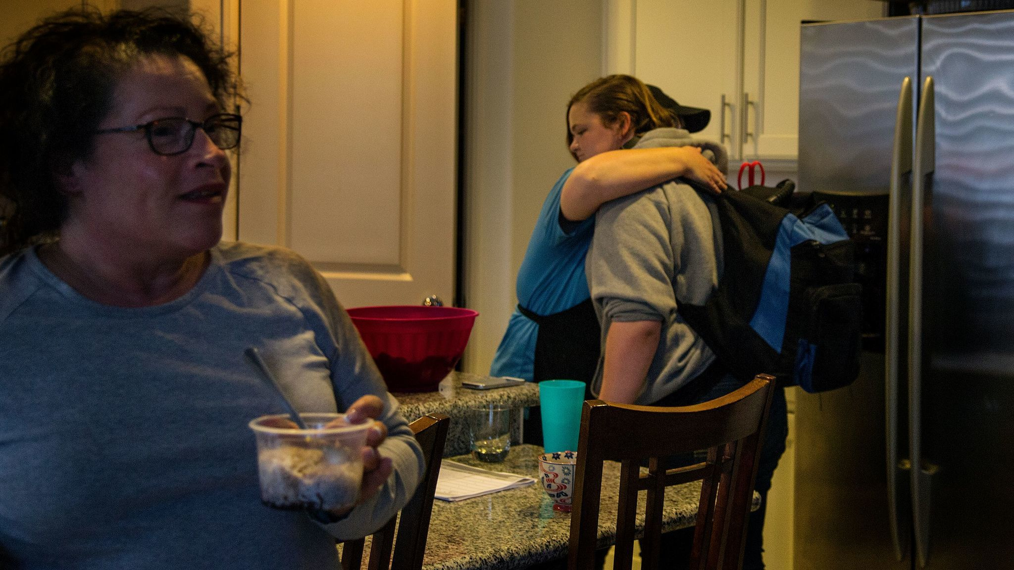 Jennifer Savit, a former inmate, embraces her 13-year-old daughter, Alissa Balcombe. The two share transitional housing in Eastvale with Monique Barr, left, and four other adults. Savit said it has kept her family from homelessness.