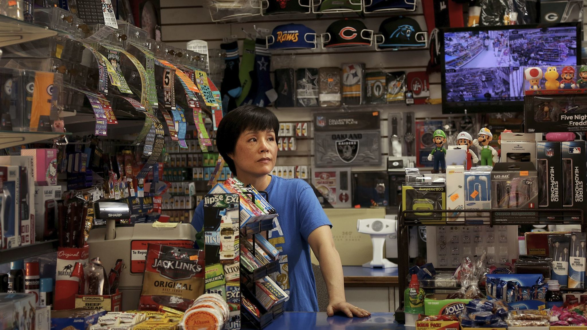 Sue Kim and her husband run a small convenience store along Cesar E. Chavez Avenue in Boyle Heights. The business has been in the family almost 40 years.