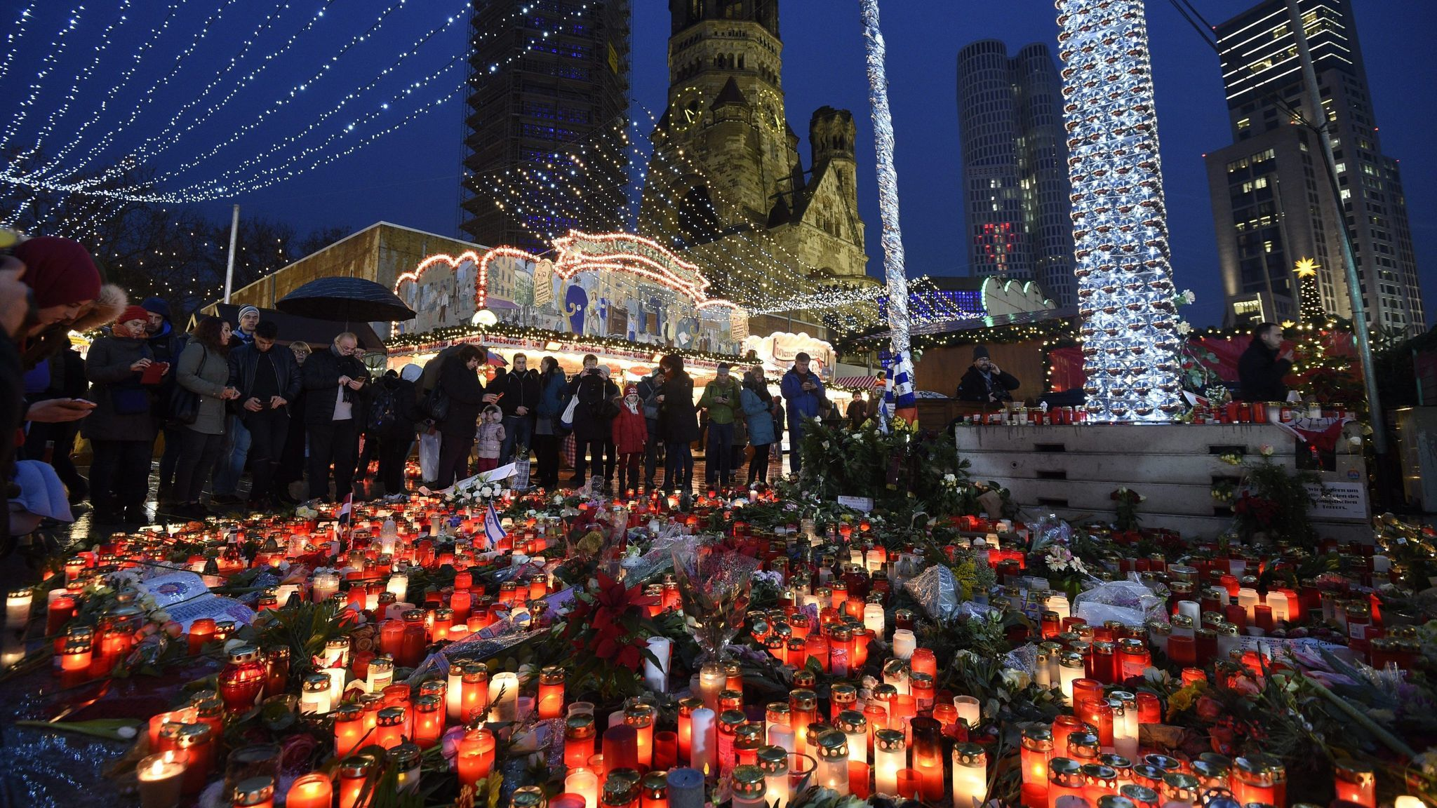 Candles illuminate the scenery at the reopened Christmas Market in Berlin, where on Dec. 19, 2016, an assailant drove a truck into a crowd.