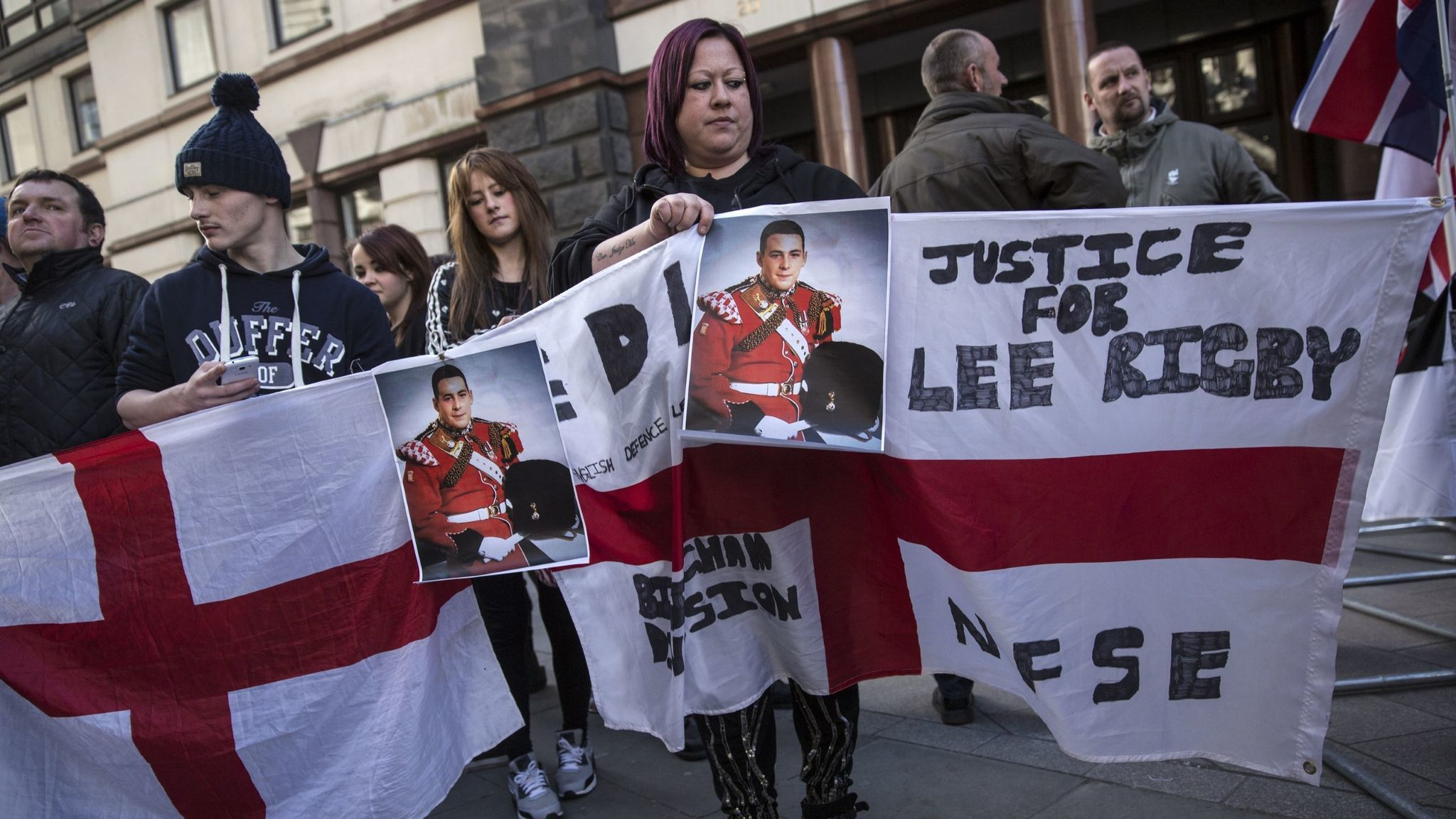 Protesters demonstrate outside the Old Bailey courthouse in London before the sentencing of Michael Adebolajo and Michael Adebowale, who were convicted of murdering British solider Lee Rigby.